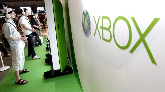 Visitors play with Microsoft's Xbox 360 consoles at the Tokyo Game Show in Chiba