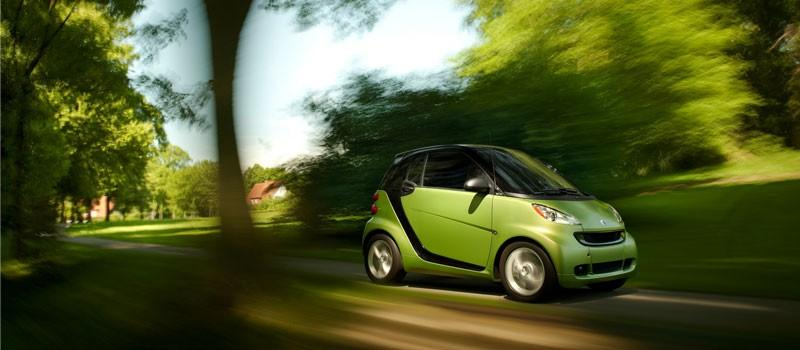A Smart for Two Coupe drives.