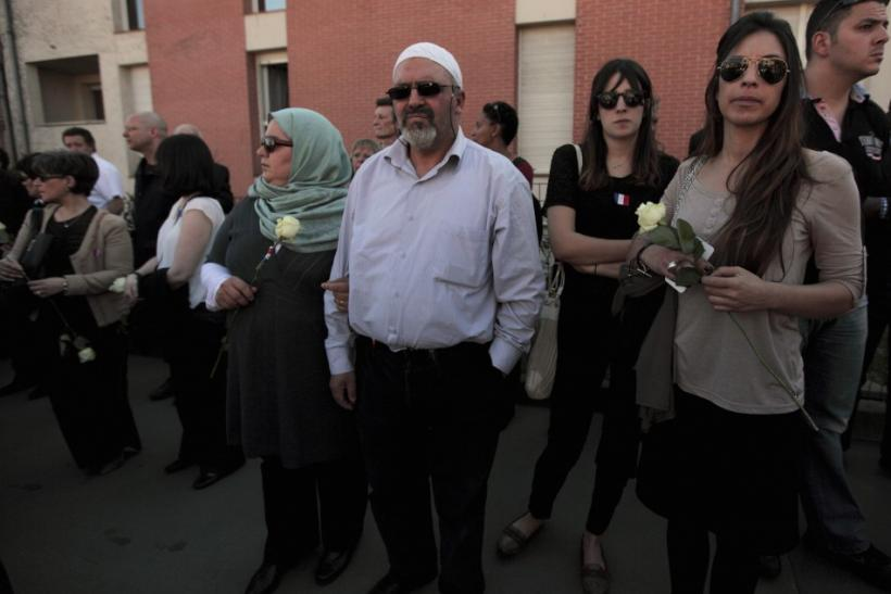 Muslim Couple attends silent march to honour victims of shooting at Ozar Hatorah school in Toulouse