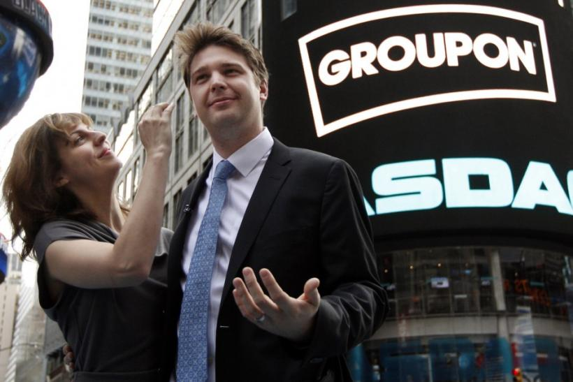 Groupon Inc. CEO Andrew Mason poses with his newly married wife, pop musician Jenny Gillespie, outside the Nasdaq Market following his company's IPO in New York, November 4, 2011.