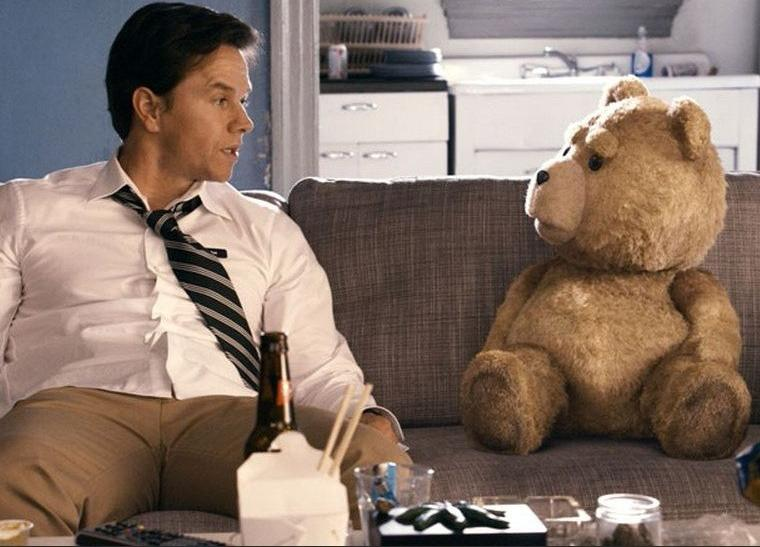 "On Monday, Universal released the first red-band trailer for Seth MacFarlane's first-ever feature-length movie, ""Ted,"" which stars Mark Wahlberg and a pot-smoking, foul-mouthed teddy bear named Ted, voiced by MacFarlane. Watch the trailer b"
