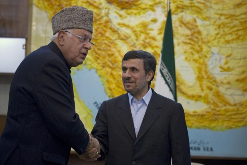 Iranian President Ahmadinejad greets India's Minister for New and Renewable Energy Abdullah in Tehran