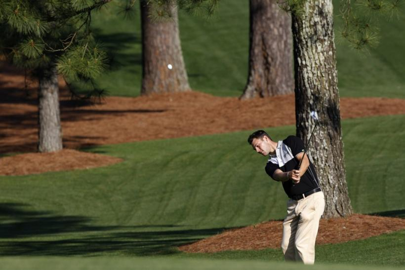 Martin Kaymer hits an approach shot at Augusta National in preparation for the Masters.