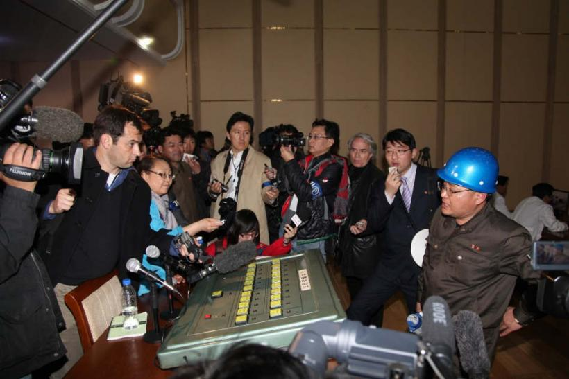 Foreign Journalists Surround a North Korean Representative