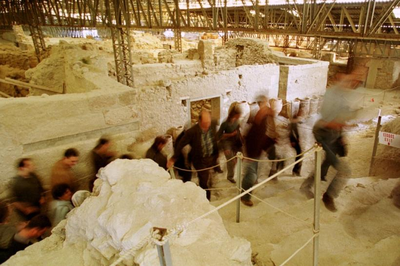 A group of journalists leave the archaeological site of prehistoric city of Akrotiri at the volcanic cycladic island of Santorini