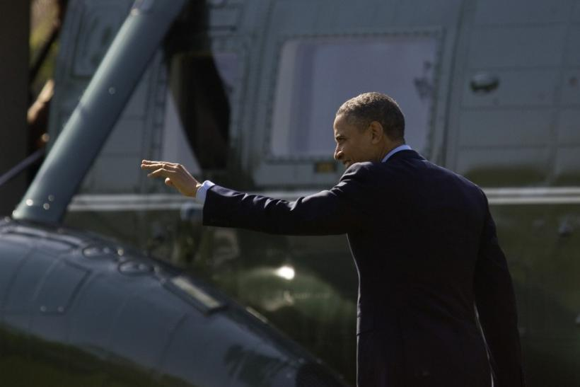 U.S. President Obama waves to visitors as he walks to the Marine One helicopter to departs for travel to Colombia for the Summit of the Americas, from the White House in Washington