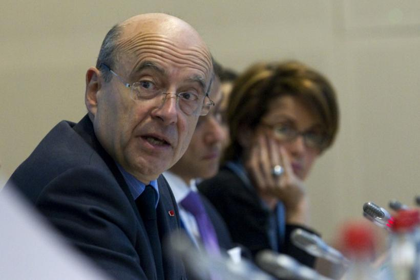 French Foreign Minister Juppe and Syrian Auditing Consultant Chatti as they attend an intern