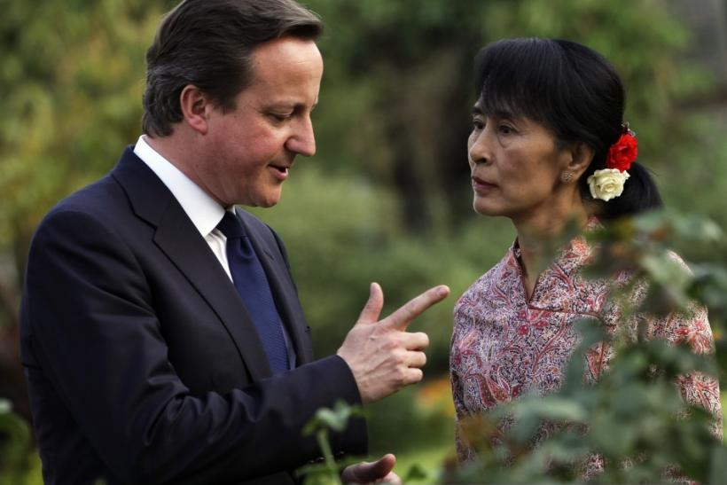 Britain's PM Cameron talks with Nobel laureate and Myanmar opposition leader Aung San Suu Kyi at her residence in Yangon