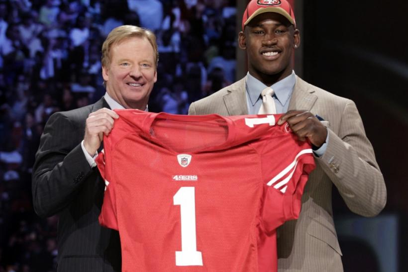 Defensive end Aldon Smith of University of Missouri with NFL Commissioner Goodell after being selected seventh overall pick by 49ers in 2011 NFL football Draft in New York