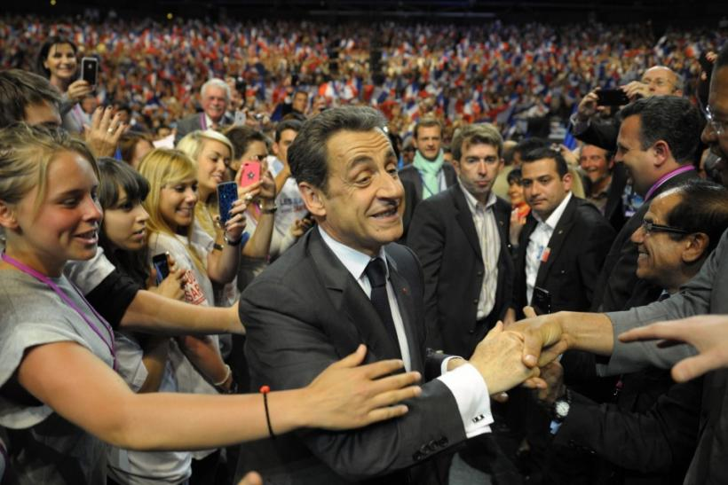 France's President and UMP party candidate for the 2012 French presidential elections Sarkozy arrives at a electoral rally in Nice Southern France