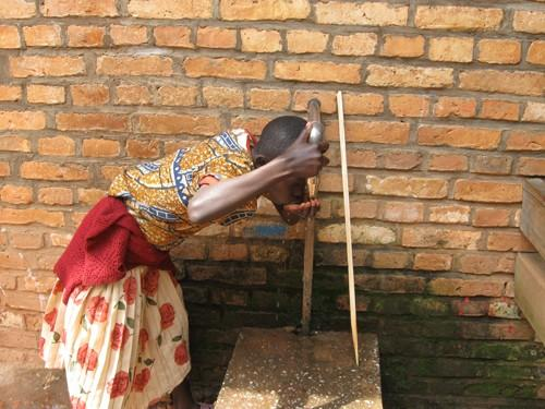 Girl Drinking Water in Rwanda.