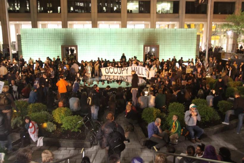 Occupy Wall Street demonstrators gather at the Vietnam Veterans Memorial Plaza, on the city park site