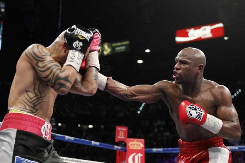 Floyd Mayweather punches Miguel Cotto during their fight Saturday night.