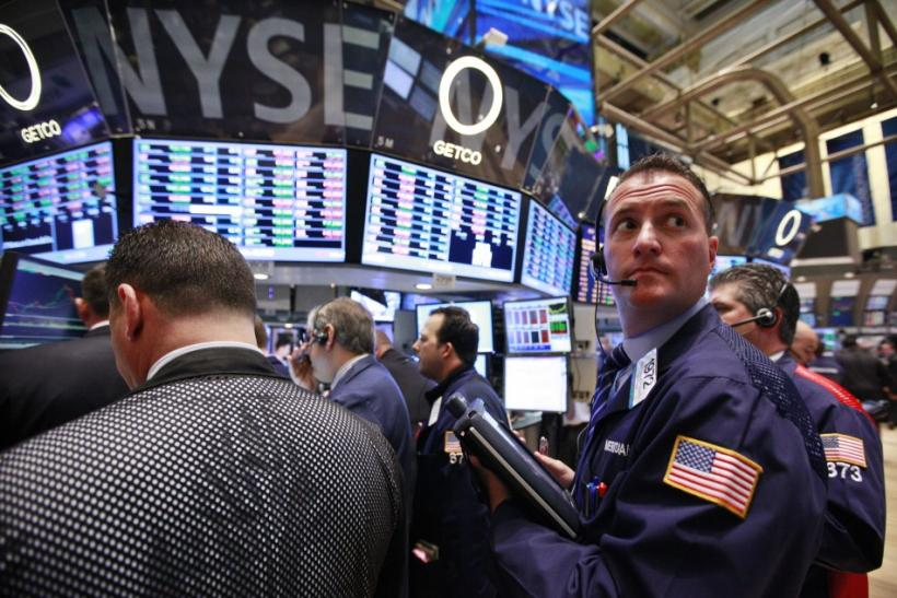 Traders work on the floor of the New York Stock Exchange on May 1, 2012.