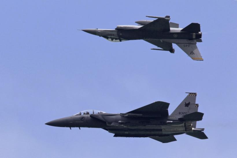F-16C and F-15SG fighter aircraft from the RSAF perform during an aerial display at Singapore Airshow in Singapore