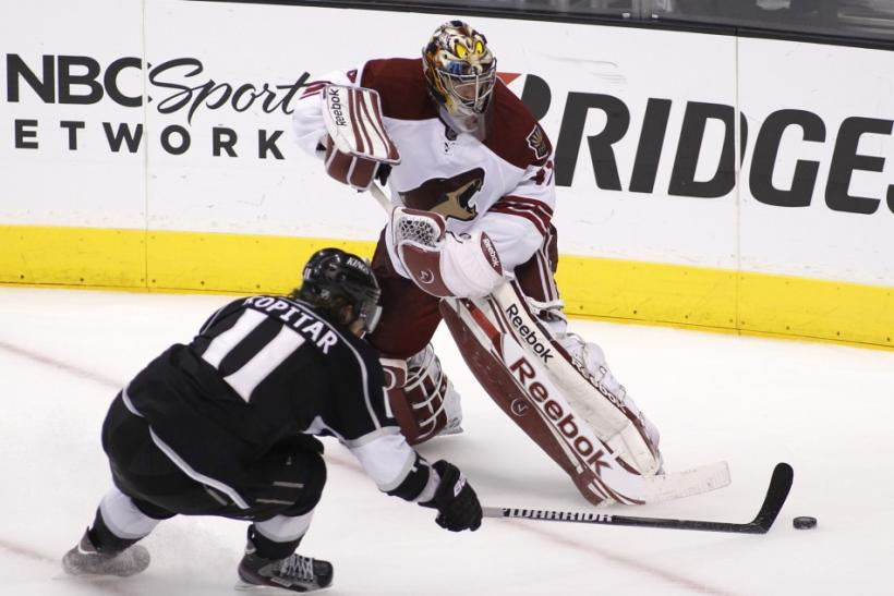 Phoenix Coyotes goalie Smith plays the puck with Los Angeles Kings' Kopitar during the second period of Game 4 of the NHL Western Conference final hockey playoffs in Los Angeles