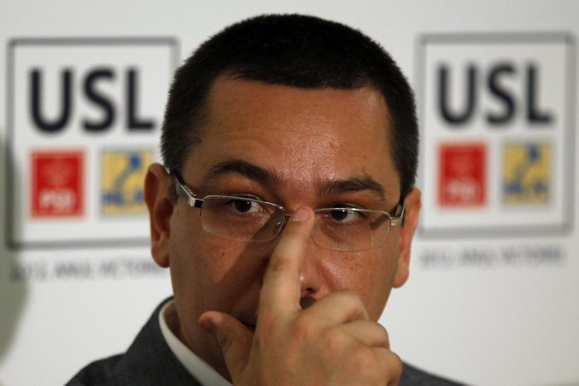 Romania's Prime Minister and Social Liberal Union alliance leader Ponta gestures during a news conference in Bucharest