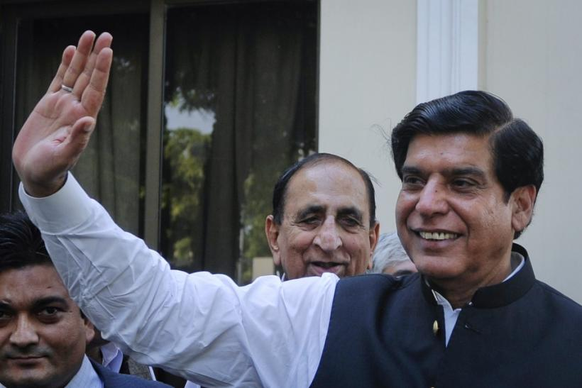 Pakistan's Prime Minister-elect Raja Pervez Ashraf waves to media in Islamabad