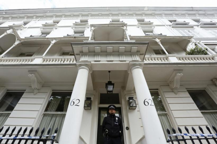 A policeman stands guard in front of the home of Eva Rausing in London