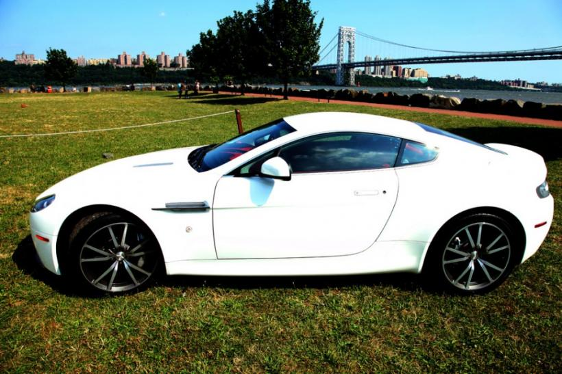 The 2012 Aston Martin V8 Vantage parked, seen from the side.