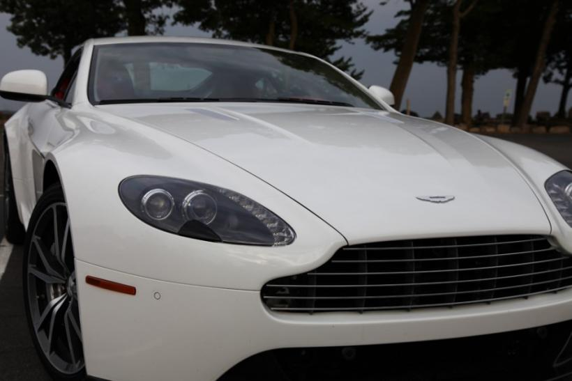 Up close with the angry-looking headlines of the 2012 Aston Martin V8 Vantage.