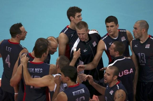 U.S. players celebrate winning their men's Group B volleyball match against Ge
