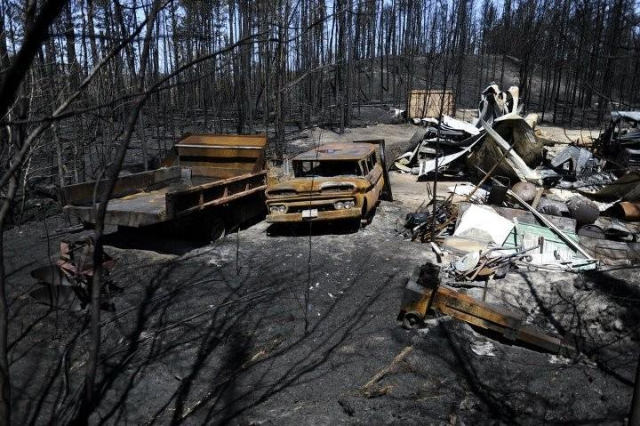 Burned wreckage in the path of the Duck Lake Fire.