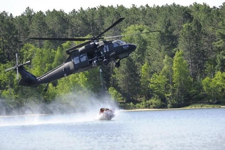 A helicopter loads up on water during the Duck Lake firefighting effort.
