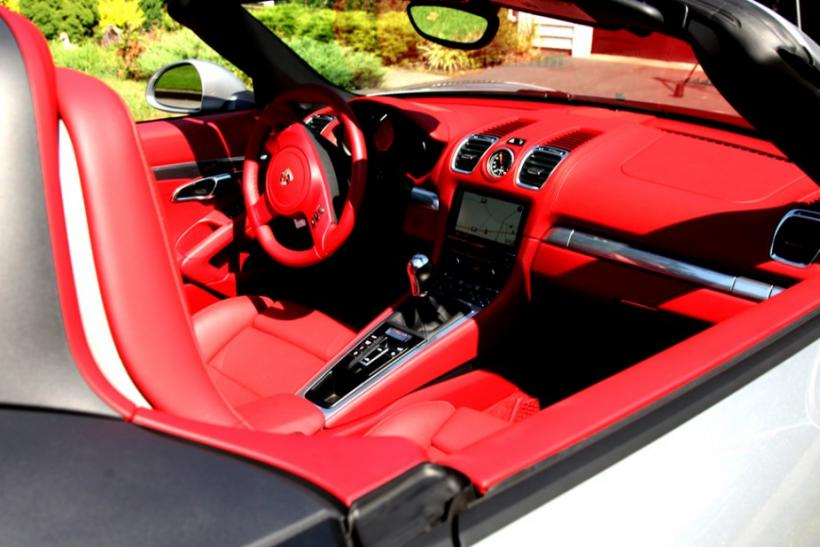 The interior of the 2013 Porsche Boxster S.