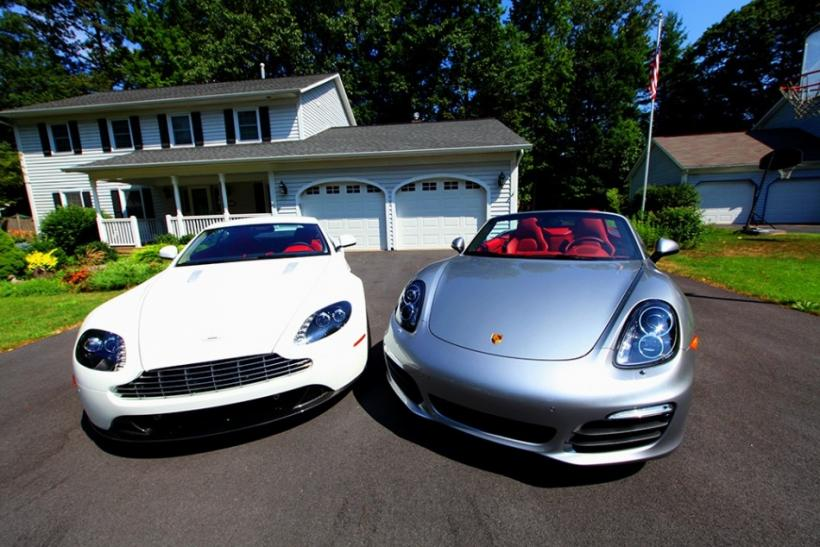 Two gorgeous cars, the Aston Martin V8 Vantage (left) and the 2013 Porsche Boxster S parked in Saratoga Springs.
