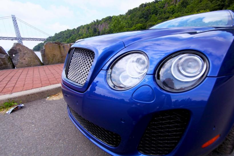 The front of the Bentley Continental Supersports Convertible with the George Washington Bridge in the background.