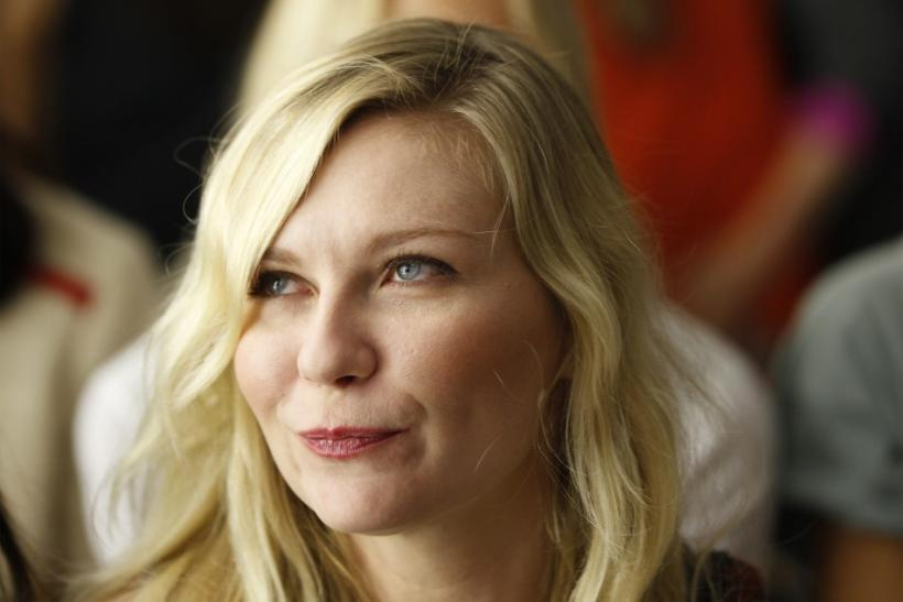 Actress Kirsten Dunst attends the Rodarte Spring/Summer 2013 collection during New York Fashion Week September 11, 2012.