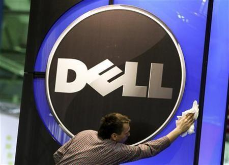 A man wipes the logo of the Dell IT firm at the CeBIT exhibition centre in Hannover
