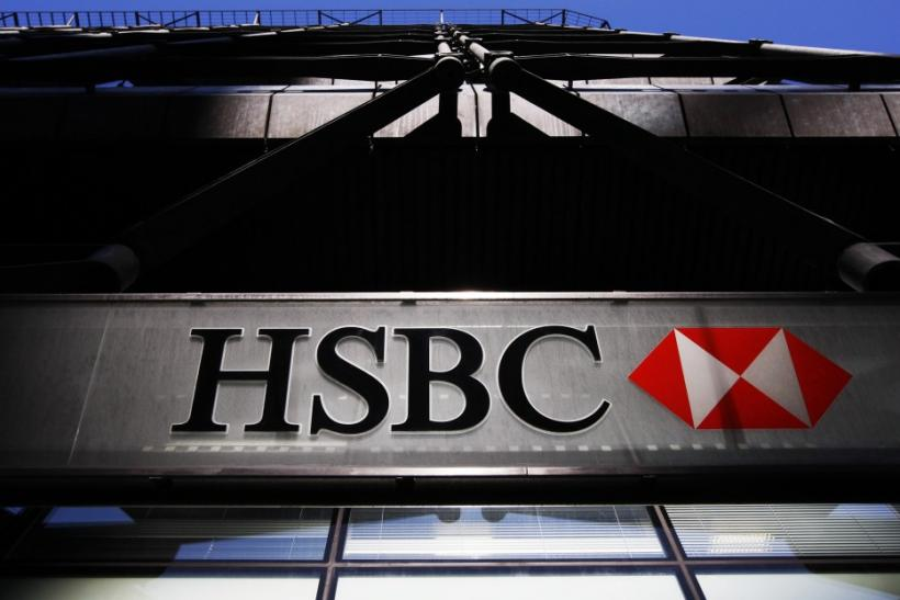 An HSBC bank logo is highlighted by the sun in London