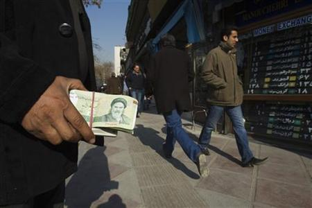 Iranian holding nearly worthless currency