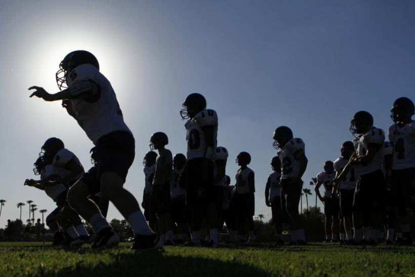 The McClintock HIgh School Chargers football team practice for their upcoming season in Tempe
