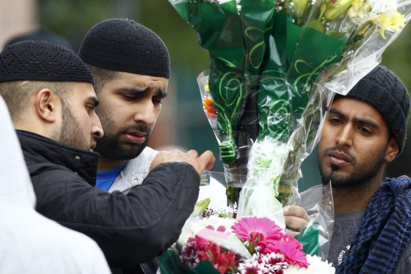 London Riots: The Face of Pain as Locals Pay Tributes to Victims