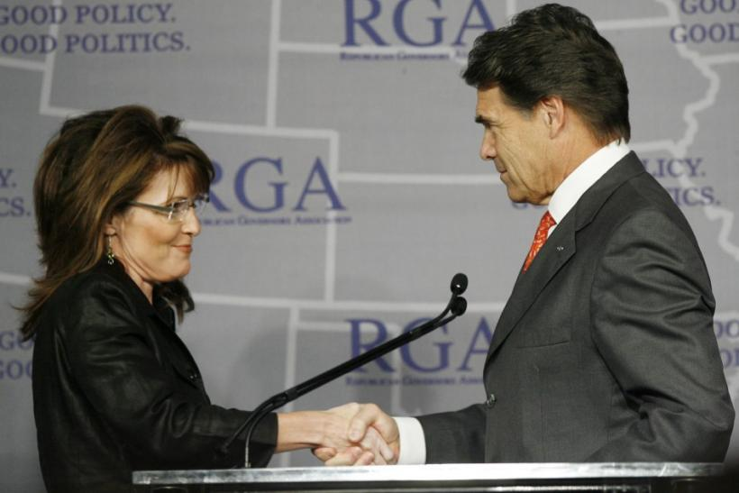 Governor Sarah Palin shakes hands with Gov. Rick Perry during a Plenary Session at the 2008 Republican Governors Association Annual Conference