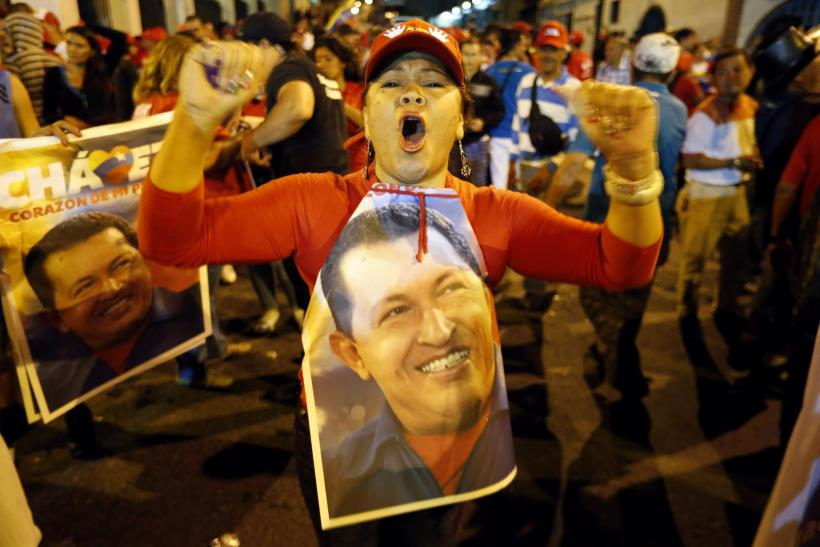 Supporters of Venezuelan President Hugo Chavez gather outside the Miraflores Palace in Caracas to wait for the results of the presidential election on Sunday.