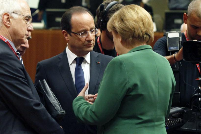French President François Hollande and German Chancellor Angela Merkel at a summit in Brussels Friday