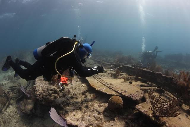 Divers examine a 1911 shipwreck off Key Largo