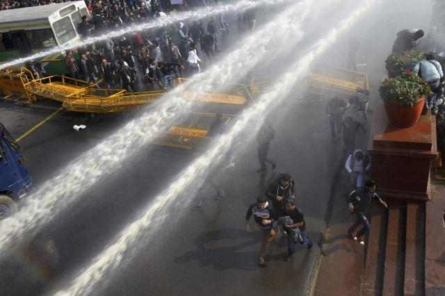 Demonstrators hit by water cannons