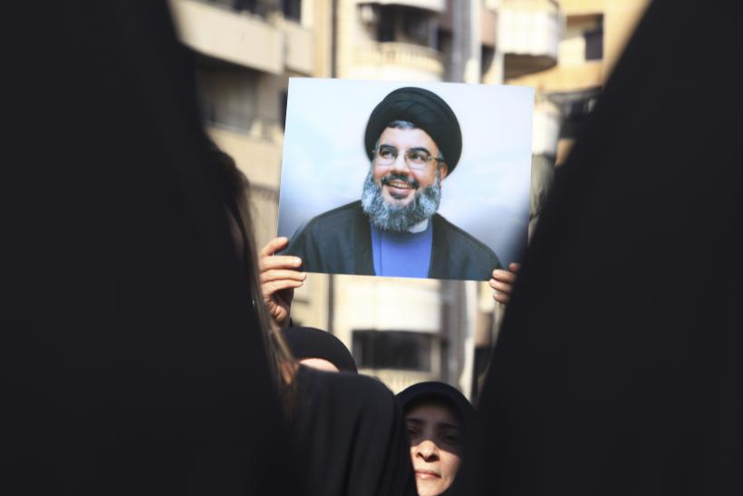 Supporter with a picture of Hassan Nasrallah