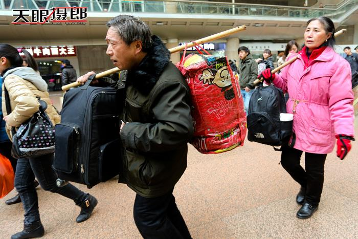 Travelers carry large bags