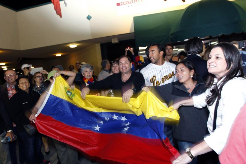 Venezuelans in US celebrate Chavez death