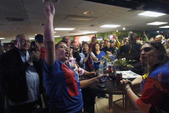 A crowd cheers at a restaurant in Florida