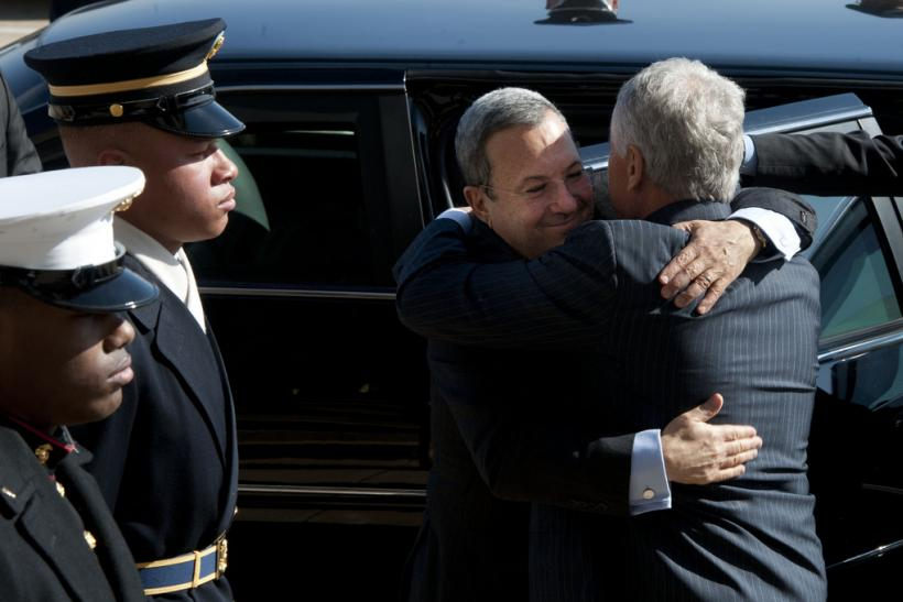 Hagel and Barak embrace at the Pentagon