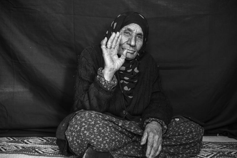 Elderly Refugee Woman With Her Ring
