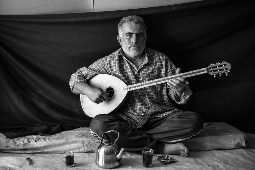 Syrian Refugee Man With His Musical Instrument