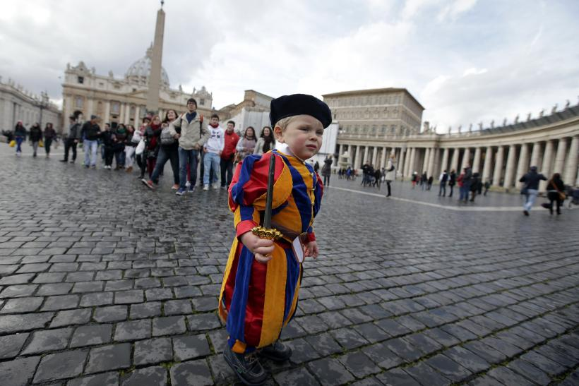 Child dressed as Swiss Guard